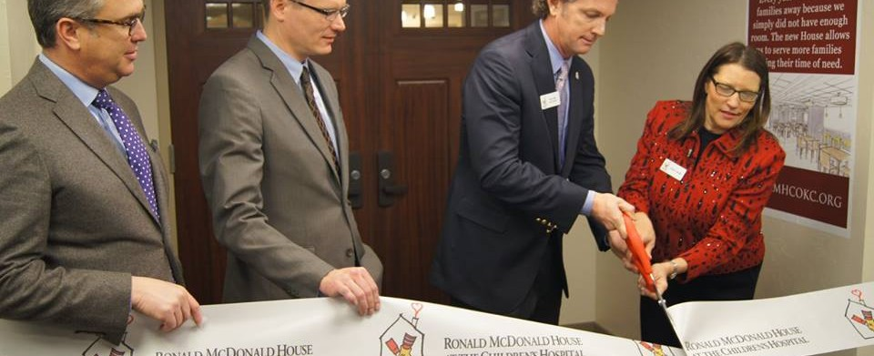 Ronald McDonald House Charities of Oklahoma City President, Susan Adams cutting the ribbon for Ronald McDonald House at the Children's Hospital in Oklahoma City