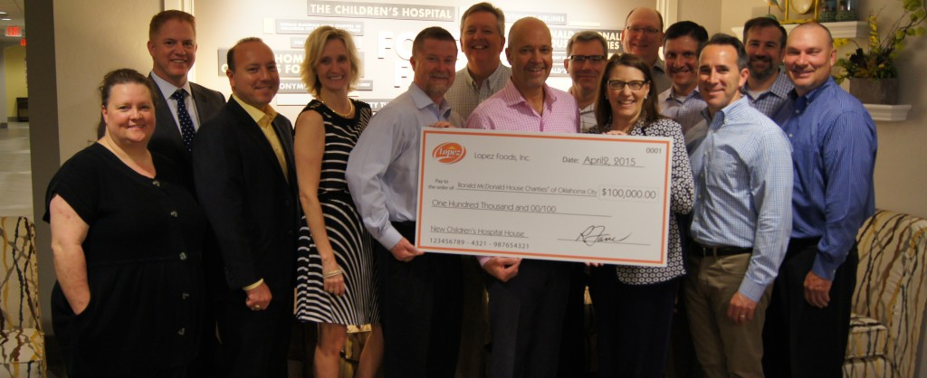 A group of employees from Lopez Foods, Inc. presenting a giant check of $100,000 to the Ronald McDonald House Charities of Oklahoma CIty President Susan Adams