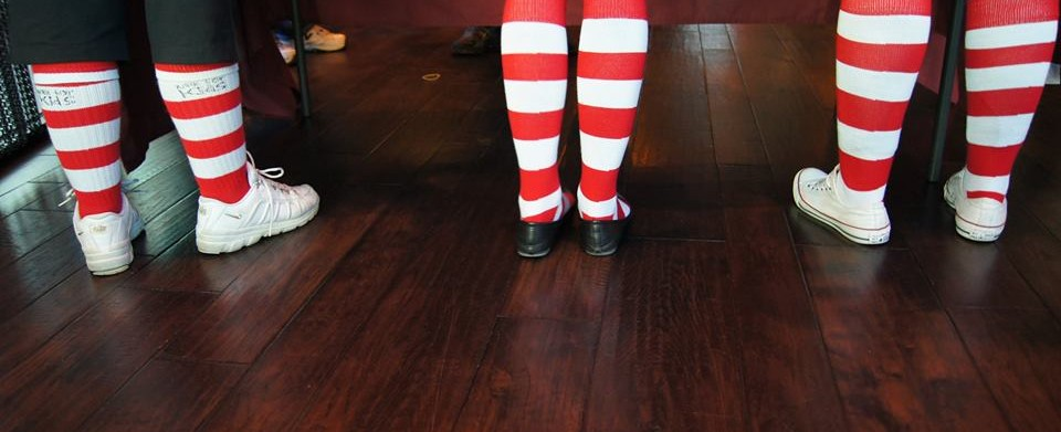 Three legs wearing red & white striped socks