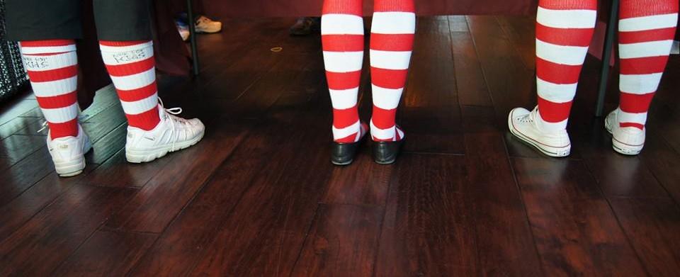 Three legs wearing red & white striped socks