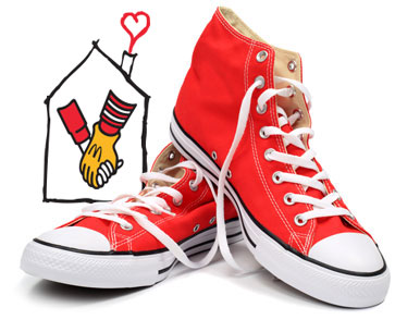 Two red shoes with the RMHC holding Hands logo