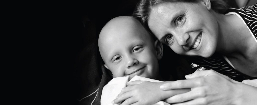 mom hugging son with cancer